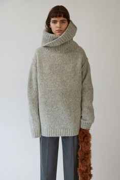 Acne Studios Aisha Alpaca silver grey is an oversized sweater with a chunky turtleneck.