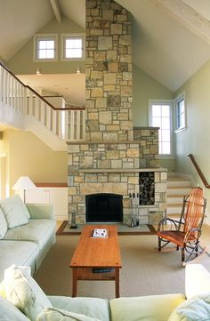 I like how the stairs hug the fireplace. Good use of square footage & the heat can get up to second floor bedrooms!