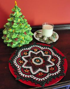 Christmas trees, in both beaded and unbeaded versions, encircle this Christmas doily by Kathryn White.