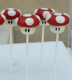 Mario cakepops *mold the cake, dip stem in white candymelts;dip top in red candymelts & press white fondant circles to the top; using an edible black marker, dot in eyes.