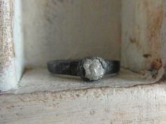 Snow white- Raw Rough Diamond - Solitaire-pave set- promise-alternative-one of a kind engagement ring-oxidized. $255.00, via Etsy.