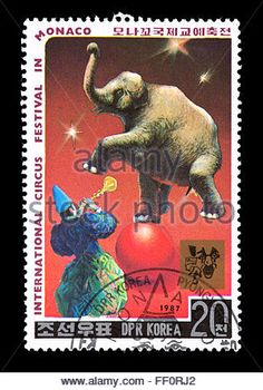 Postage stamp from North Korea depicting a clown and an elephant balancing on a ball, international Circus Exhibition - Stock Photo