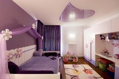"""A combination of a matt and lacquer stretch ceiling in a girl's room. The form of heart is made of a purple stretch foil together with """"Starry Sky"""" effect."""