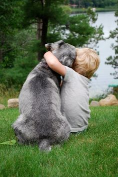 Portrait of a boy and his dog.