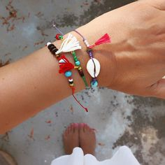"""These delicate charm bracelets will adorn your wrist with style,  Colorful, elegant and so lightweight that you forget you have them on, they make the perfect summer accessory.      The set includes three bracelets made of waxed cord in green, red and purple.      Handmade with love in my home studio in Amorgos island  Length 18 cm/ 7,08"""", adjustable    See more boho chic jewelry from Maslinda Designs  http://www.etsy.com/shop/maslinda    Please read my policies for shipping payments…"""