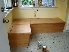 Kitchen bench seating with storage--hinged top. Liking the idea of drawers more and more, though