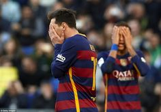 Messi and Neymar both cover their faces after the Argentine hit the crossbar with a curling free-kick 10 minutes before half-time