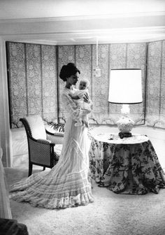 Audrey Hepburn Dotti photographed with her son Luca Dotti by Bob Willoughby inside her room at her house in Rome (Italy), in May 1970. -Audrey was wearing an evening gown created especially for her by Valentino. Note: Audrey's hairstyle was created and done by Alexandre de Paris.
