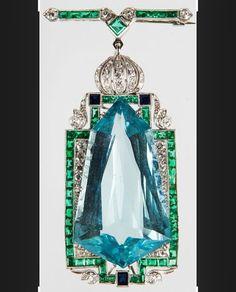An aquamarine, emerald and diamond brooch, Art Deco period. #artdecojewelry #aquamarine #vintagejewelry