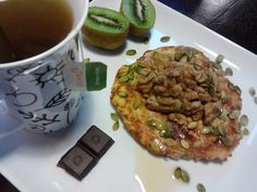 Healthy breakfast pancake-paleo, gluten, dairy and sugar free.Topped with raw activated walnuts and pumpkin seeds and maple syrup. Served with organic three mint peppermint tea and Loving Earth raw organic dark chocolate.