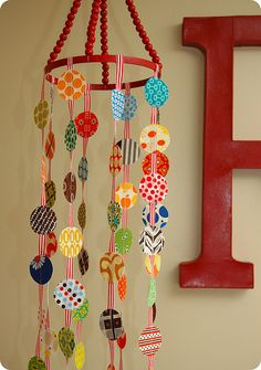 Love the hand made baby mobile. This one is made with fabric circles and ribbon.