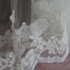 - Product Info - Veils Colors - Brides' Comments Beautiful two tier lace wedding veil with laces edges, accented with pearl and sequins. Top tier can also be used as a blusher. This is a longer versio