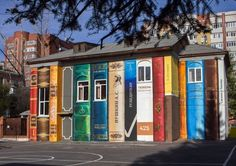 A rundown building given the book treatment by art group Color of the City in Tyumen, Russia.