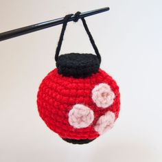 "These little amigurumi lanterns are based on the paper lanterns seen so often in Japan. The round red lantern is decorated with three cherry blossoms and the tall white lantern features the kanji character for ""strength. Crochet Lamp, Crochet Eyes, Diy Crochet, Crochet Crafts, Yarn Crafts, Paper Crafts, Octopus Crochet Pattern, Crochet Dolls Free Patterns, Diy Sewing Projects"