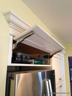 Kitchen Cabinets Remodeling kitchen cabinet storage solutions, kitchen design, shelving ideas, storage ideas, This unique awning or uplift style cabinet hinge makes the tray shelf easily accessible - … Kitchen Cabinet Storage, New Kitchen Cabinets, Kitchen Redo, Kitchen Pantry, Storage Cabinets, Kitchen Design, Kitchen Ideas, Fridge Storage, Smart Kitchen