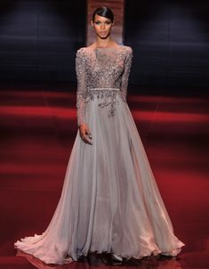 """From our PARIS HAUTE COUTURE chapter. Cascades of silver with an almost liquid look on dresses reminding of the """"A Thousand and One Night"""" atmosphere with very long trains and ethereal but precious fabrics. #wedding #dress #weddingdress #bride #eliesaab @Karmien Nys Saab #look #style #fashion #woman #athousandandonenight #precious #hautecouture #paris #catwalk"""