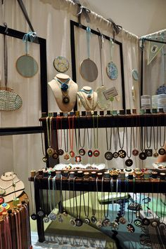I LOVE this display at Whimsy House's booth - necklaces hanging from vitnage thread spools!- The Creative Connection 2011