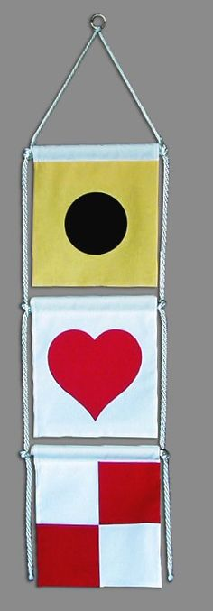 """If you're looking for a way to say """"I Love You"""" with nautical flags, you'll love our new banner! It comes ready to hang, right out of the package, and includes the flags, all the rope, and a brass ring at the top. We think it's great for nautical weddings and receptions, but you can use it for almost any occasion. This is on our order form at our website IB Designs, USA"""