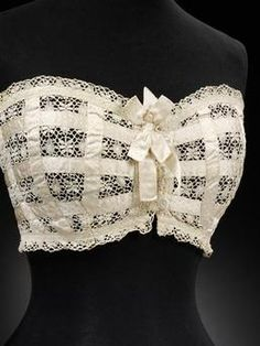 improver Bust Improver - c. 1910 - Dickins & Jones (retailer) - Lace and ribbon, mother-of-pearl - Made in United KingdomBust Improver - c. 1910 - Dickins & Jones (retailer) - Lace and ribbon, mother-of-pearl - Made in United Kingdom Lingerie Vintage, Vintage Underwear, Lace Lingerie, Lingerie Models, Style Édouardien, Mode Style, Vintage Outfits, Vintage Dresses, Historical Costume