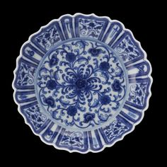 Chinese blue and white porcelain lobed dish yongzheng six character mark, 19th century or earlier the lobed sides rising from a short tapering foot to an everted foliate rim, similarly decorated inside and out with peony, lotus, foliage and eight Daoist symbols.
