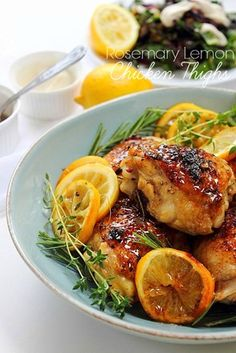 Rosemary Lemon Baked Chicken Thighs! Seriously the best thing EVER! #paleo #chickenaddict #crispyskin