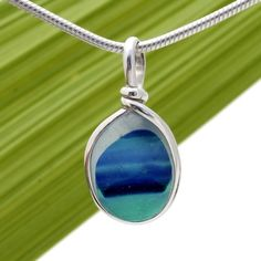 An amazing combination of vivid mixed aqua and blue in this very old English Sea Glass piece and set in our Original Wire Bezel© necklace pendant setting