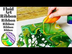 Ribbon Pour. This month's fluid acrylic paint pouring challenge is to create a fluid art acrylic paint pour piece using a ribboning technique. The colors tha...