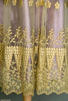 EMBROIDERED TEA GOWN, 1914-1918 Cream cotton net, floral embroidery, lilac underdress. Detail