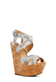 Miabella by JustFab is a fun, patterned wedge and so summer-chic, especially with tribal printed fabric straps and real cork wrap. Features an open back counter with adjustable ankle buckle.