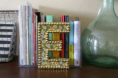 DIY nailhead home decor letter - use thumbstacks from the dollar store!