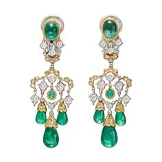 Buccellati Emerald Drop Chandelier Earrings Chandelier earrings, designed with three drop-shaped emerald beads with rose-cut diamond-set caps suspended from an openwork white and yellow gold central area accented by full-cut diamonds and a central cabochon emerald, to a yellow and white gold surmount accented by full-cut diamonds and a larger oval-shaped cabochon emerald, 18k gold,  signed Gianmaria Buccellati