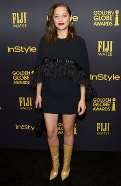 14 Superhero Celebrities Rocking Chic Capes - Marion Cotillard from InStyle.com