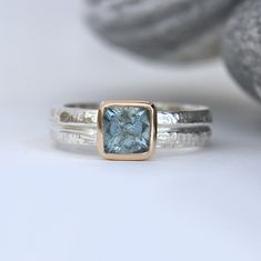 silver and gold aquamarine finger ring