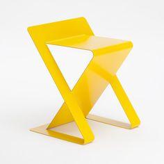 Yellow sheet metal chair