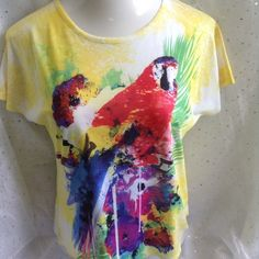 Breckenridge Double Parrot Bling Tee Petite Med This is great cruise wear or even your next Jimmy Buffet concert!  Charming, colorful parrot appears on both sides of shirt.  Bling on front only.  100% polyester.  Measurements to follow Breckenridge Tops Tees - Short Sleeve