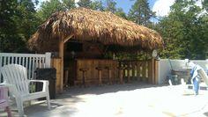 "Marmora, NJ. 14 x 14 Tiki Hut, 14 x 8 solid cedar back wall, two 14' x 42"" side railings with 12"" bar top, 8x8 custom red cedar tiki bar,  beach sand floor, 12 Tiki Kev swivel bar stools. Click here for full description and photo album: https://www.facebook.com/media/set/?set=a.10153047187209616.1073741914.206799659615&type=3 , www.tikikev.com, 800-792-8454"