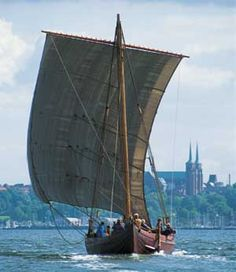 Roskilde Fjord: You can tell, this is Roskilde by the two towers of the Cathedral in the background and the viking ship from The Viking Museum.