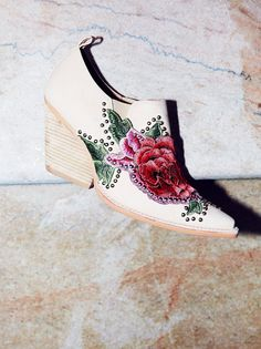 Knock Out Ankle Boot | Western-inspired ankle boot with a leather or denim design. Features a beautiful, bold floral patch detail and simple stud accents throughout. Chunky heel and sleek pointed toe design. Pull tab and elastic side panels for an easy on-off.