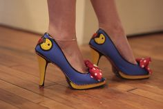 Custom painted Pacman Shoes! They are created by Kate Renee at katerenee.com. Want a pair? Here's how it works: You buy the shoes so they fit and are comfortable. Pick a theme you would like for me to paint on them. I love rhinestones and I hope you do too… I can do a ton, or a few tastefully. I truly wish to make your shoes one of a kind for any special event or occasion! These shoes were designed for the Level_13: Cheat Codes Art Exhibition at Altered Esthetics which featured video game…