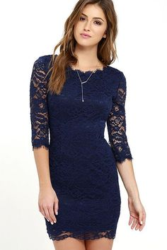 Make an Impression Navy Blue Lace Dress! Lovely eyelash lace overlay tops a navy blue knit lining, creating a bateau neckline, darted bodice, and sheer, three-quarter sleeves. Bodycon skirt ends with a sheer hem. Hidden back zipper/hook clasp.