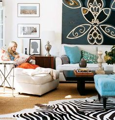 Love the colors, and cozy collection of furniture here. Great ottoman and rug too!