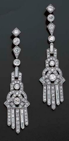 PAIR OF EARRINGS PENDANTS ART DECO DIAMOND Adorned with a fall of geometric patterns and pendants set with round diamonds and baguettes, platinum setting, stems gold, circa 1930