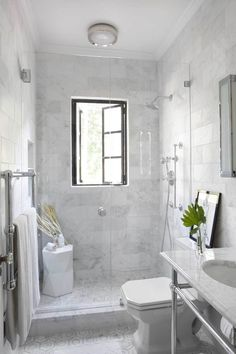 All marble bathroom with an open vanity
