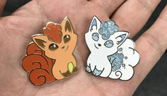 Your choice of one super cute Vulpix enamel pin about 1.25 tall. The Kanto(fire) vulpix is accented in gold metal and the Alolan Vulpix with silver metal. The Alolan Vulpix has glitter accents that catch the light just right. Get the Both Vulpixes option to get one of each with a bit of a discount. Just the right size to wear on your jacket collar or a backpack - a rubber clutch on the back will keep your pin securely in place.