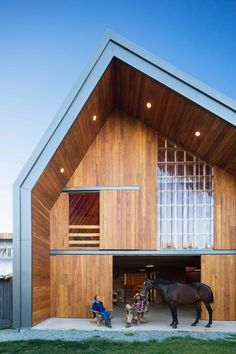 The building is clad entirely in vertical Douglas fir siding