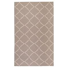 """Anchor your living room seating group or define space in the den with this artfully hand-woven wool rug, showcasing a quatrefoil trellis motif for eye-catching appeal.  Product: RugConstruction Material: 100% WoolColor: Dark TaupeFeatures:  Hand-wovenMade in IndiaPile Height: 0.16""""    Note: Please be aware that actual colors may vary from those shown on your screen. Accent rugs may also not show the entire pattern that the corresponding area rugs have.Cleaning and Care: Vacuum regularly ..."""