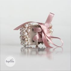 This wonderful bracelet was made of freshwater pearls, each in white and pale pink color. The sizes of the pearls are 4 and 6 mm and I sewed them by hand onto a 5 cm wide white Italian leather. The closure is a pink silk ribbon. Pink Silk, Pale Pink, Pink Color, Bridal Bangles, Bridal Bracelet, Bangles Making, Jewelry Design, Unique Jewelry, Silk Ribbon