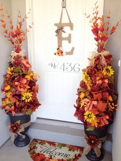 Fall Time porch! Made these cute topiaries out of tomato cages!