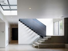 Stunning Modern Residence with Spacious Interior: Spacious Kohout Residence Indoor Staircase Area With Less Furnishing Displaying Dark Black. Stairs And Doors, Marble Staircase, Steel Stairs, Interior Architecture, Interior Design, Architectural Features, Stairways, Second Floor, Foyer