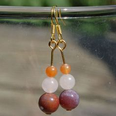 Gemstone earrings / dangles 'Red' by StudioPaars on Etsy. The gemstones I used are Fancy Jasper, Rose Quartz and Red Aventurine combined with gold-coloured metal. #StudioPaars